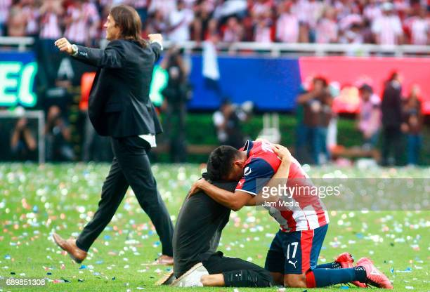 Jesús Sánchez of Chivas celebrates the championship as his coach Matias Almeyda walks behind him after winning the Final second leg match between...
