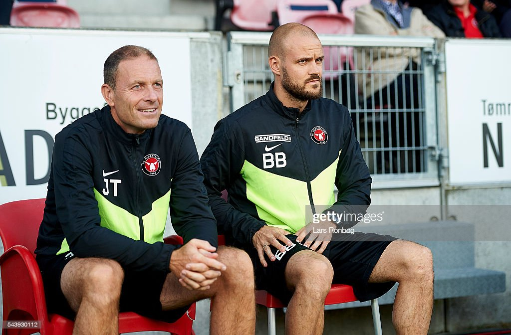 Jess Thorup, head coach of FC Midtjylland and Kristian Bach Bak, assistant coach of FC Midtjylland looks on during the Europa League Qualifier match between FC Midtjylland and FK Suduva at MCH Arena on June 30, 2016 in Herning, Denmark.