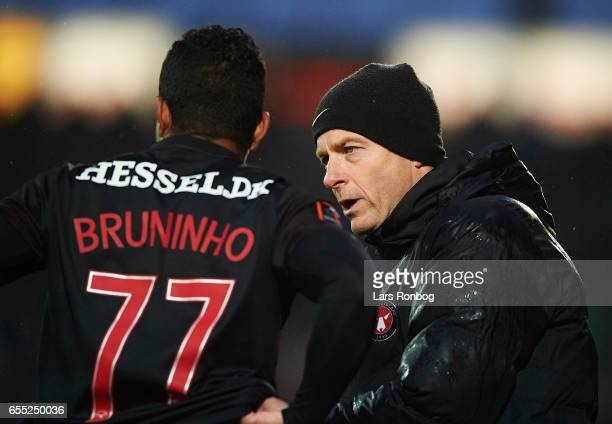 Jess Thorup head coach of FC Midtjylland speaks to Bruninho of FC Midtjylland during the Danish Alka Superliga match between FC Midtjylland and FC...