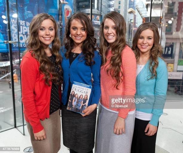 Jessa Duggar Jinger Duggar Jill Duggar and Jana Duggar visit 'Extra' at their New York studios at HM in Times Square on March 11 2014 in New York City