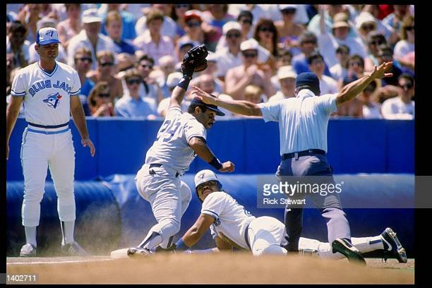 Jesse Barfield of the Toronto Blue Jays slides into a base for a triple during a game Mandatory Credit Rick Stewart /Allsport