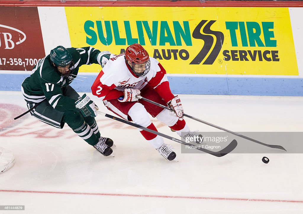 Jesse Beamish #17 of the Dartmouth College Big Green chases Ahti Oksanen #2 of the Boston University Terriers during NCAA hockey action at Agganis Arena on January 8, 2014 in Boston, Massachusetts.