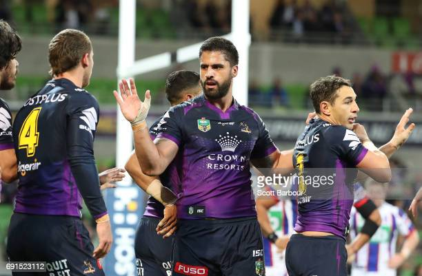 Jesse Bromwich and Billy Slater of the Storm celebrate after a try during the round 13 NRL match between the Melbourne Storm and the Newcastle...