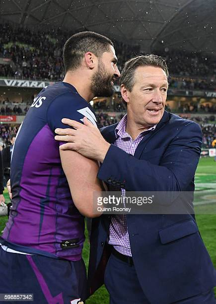 Jesse Bromwich and Craig Bellamy of the Storm celebrate winning the round 26 NRL match between the Melbourne Storm and the Cronulla Sharks at AAMI...