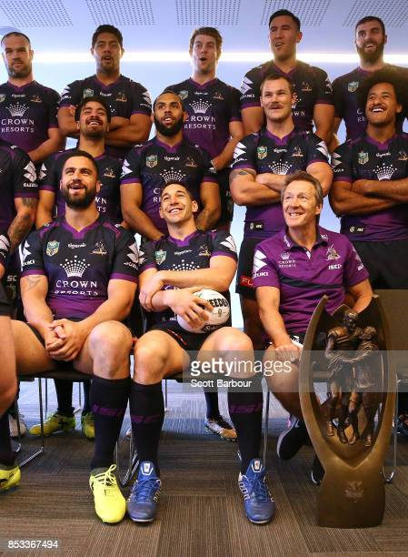 Jesse Bromwich Billy Slater and coach Craig Bellamy laugh as they pose for their team photo with the ProvanSummons trophy during a Melbourne Storm...