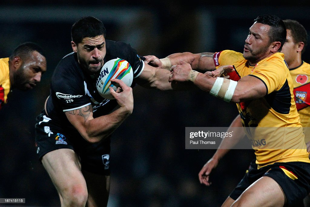 Jesse Bromwich (C) of New Zealand is tackled by Jason Chan of Papua New Guinea during the Rugby League World Cup Group B match at Headingley Stadium on November 8, 2013 in Leeds, England.