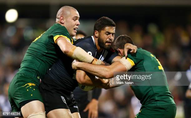 Jesse Bromwich of the Kiwis is tackled during the ANZAC Test match between the Australian Kangaroos and the New Zealand Kiwis at GIO Stadium on May 5...
