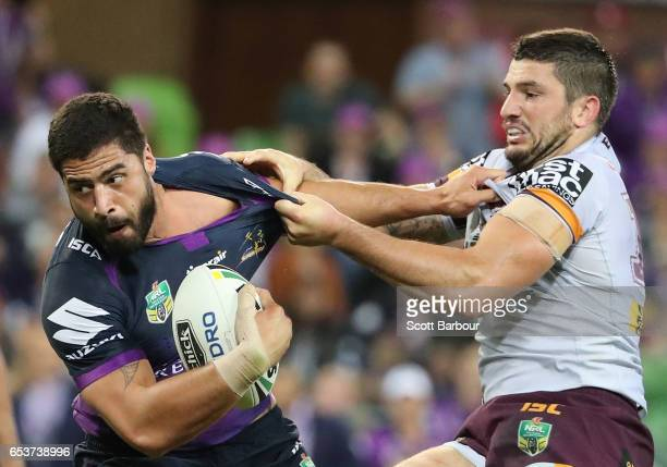 Jesse Bromwich of the Melbourne Storm is tackled by Matt Gillett of the Broncos during the round three NRL match between the Melbourne Storm and the...