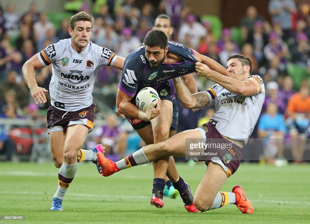 Jesse Bromwich of the Melbourne Storm is tackled by Matt Gillett of the Broncos during the round three NRL match between the Melbourne Storm and the Brisbane Broncos at AAMI Park on March 16, 2017 in Melbourne, Australia.