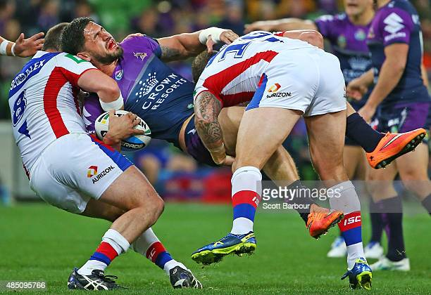 Jesse Bromwich of the Melbourne Storm is tackled during the round 24 NRL match between the Melbourne Storm and the Newcastle Knights at AAMI Park on...