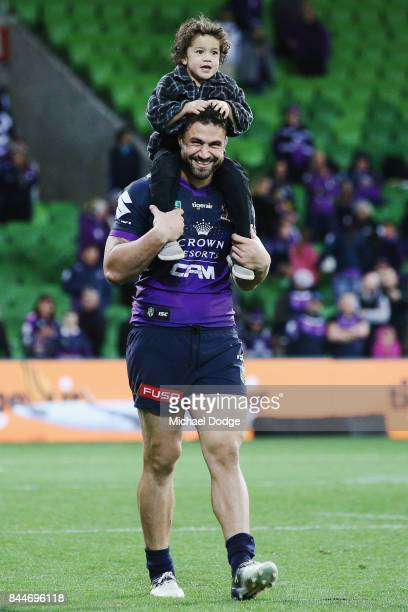 Jesse Bromwich of the Storm celebrates the win with his son during the NRL Qualifying Final match between the Melbourne Storm and the Parramatta Eels...