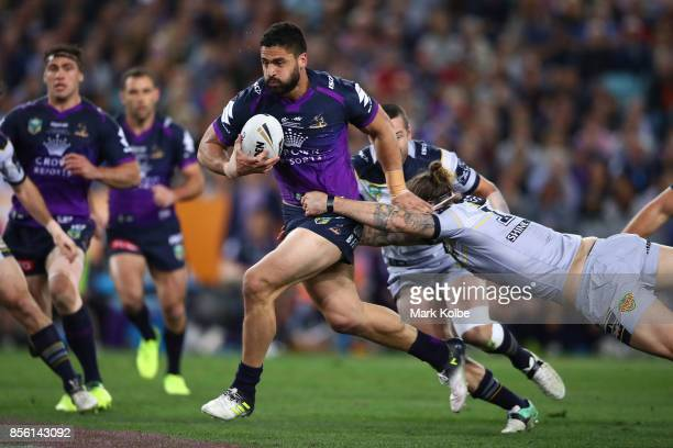 Jesse Bromwich of the Storm is tackled during the 2017 NRL Grand Final match between the Melbourne Storm and the North Queensland Cowboys at ANZ...