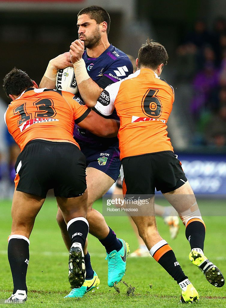 Jesse Bromwich of the Storm is tackled during the round 16 NRL match between the Melbourne Storm and Wests Tigers at AAMI Park on June 26, 2016 in Melbourne, Australia.