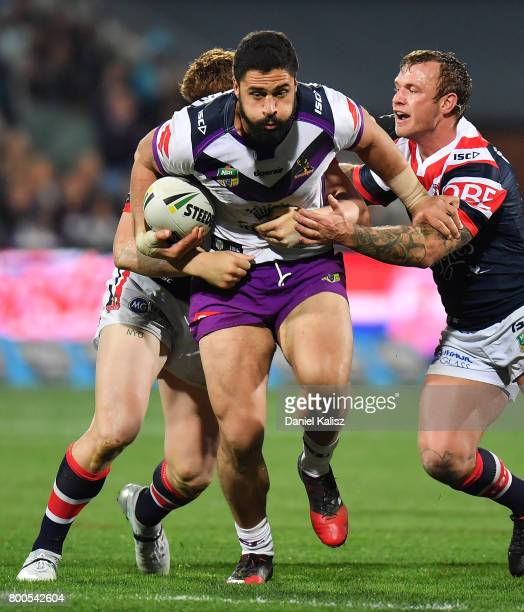 Jesse Bromwich of the Storm is tackled during the round 16 NRL match between the Sydney Roosters and the Melbourne Storm at Adelaide Oval on June 24...