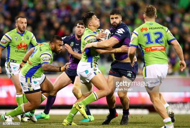 Jesse Bromwich of the Storm is tackled during the round 20 NRL match between the Canberra Raiders and the Melbourne Storm at GIO Stadium on July 22...