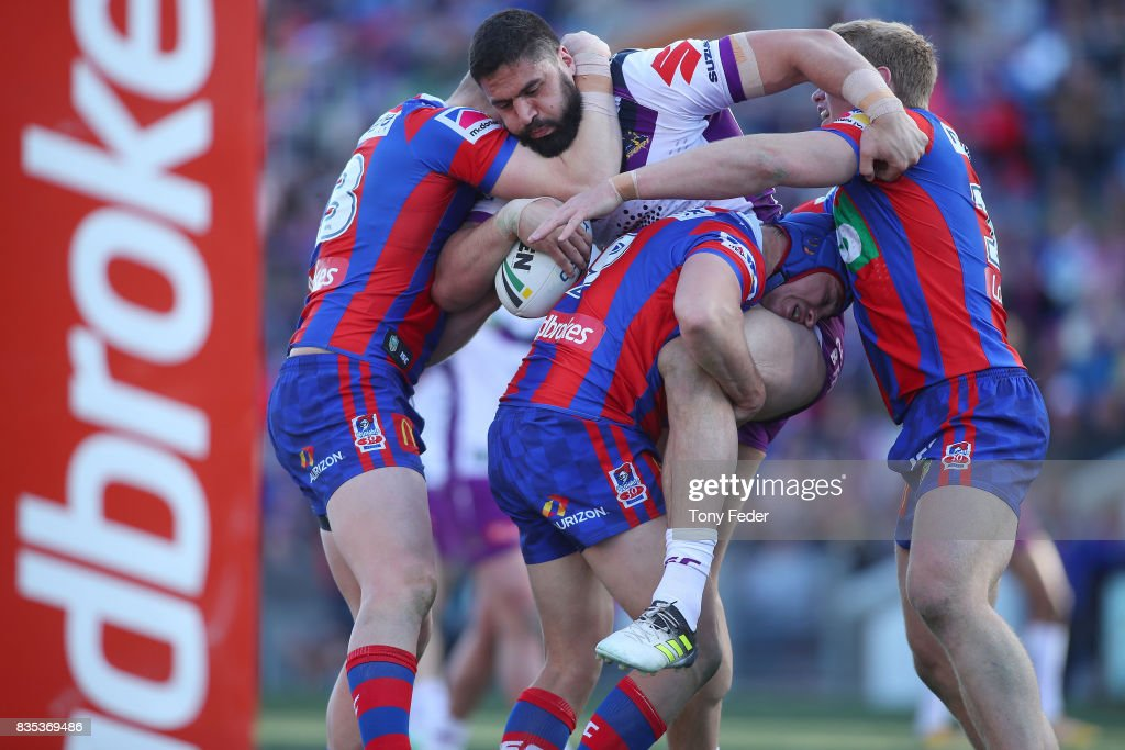 Jesse Bromwich of the Storm is tackled during the round 24 NRL match between the Newcastle Knights and the Melbourne Storm at McDonald Jones Stadium on August 19, 2017 in Newcastle, Australia.