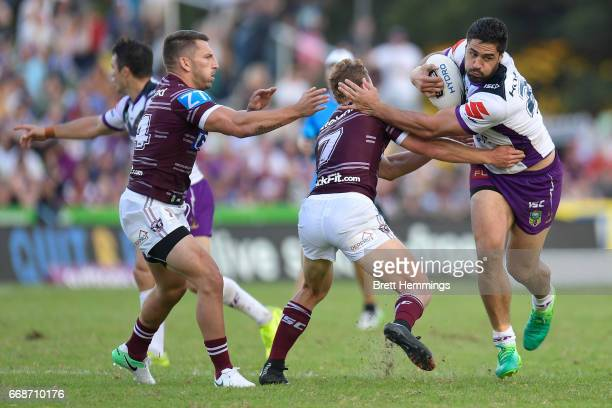 Jesse Bromwich of the Storm is tackled during the round seven NRL match between the Manly Sea Eagles and the Melbourne Storm at Lottoland on April 15...