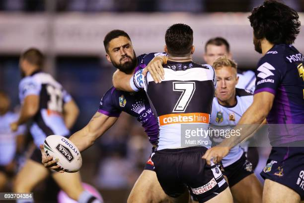 Jesse Bromwich of the Storm offloads the ball in a tackle during the round 14 NRL match between the Cronulla Sharks and the Melbourne Storm at...