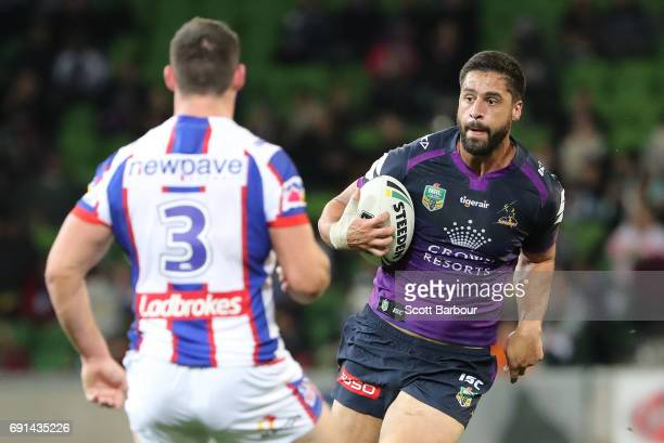 Jesse Bromwich of the Storm runs with the ball during the round 13 NRL match between the Melbourne Storm and the Newcastle Knights at AAMI Park on...