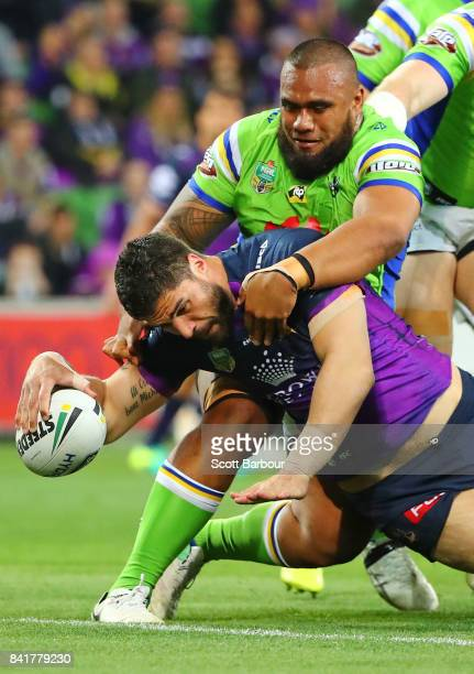 Jesse Bromwich of the Storm scores a try during the round 26 NRL match between the Melbourne Storm and the Canberra Raiders at AAMI Park on September...