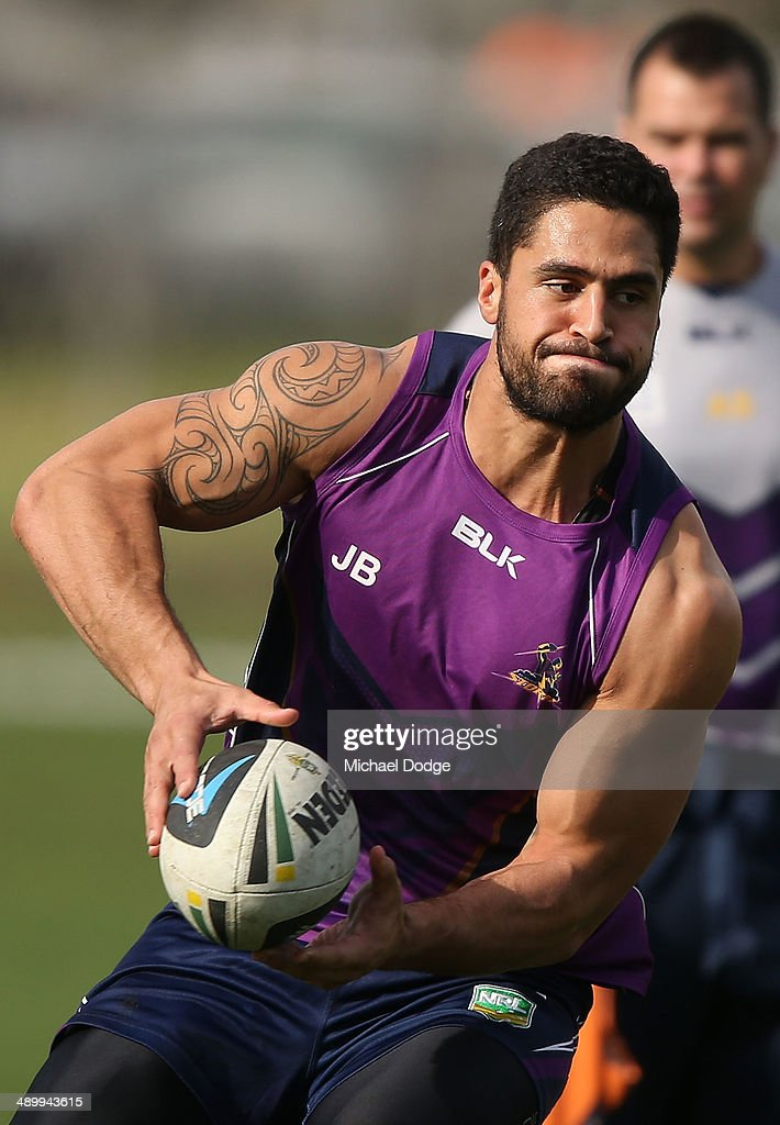 Jesse Bromwich passes the ball during a Melbourne Storm NRL training session at Gosch's Paddock on May 13, 2014 in Melbourne, Australia.
