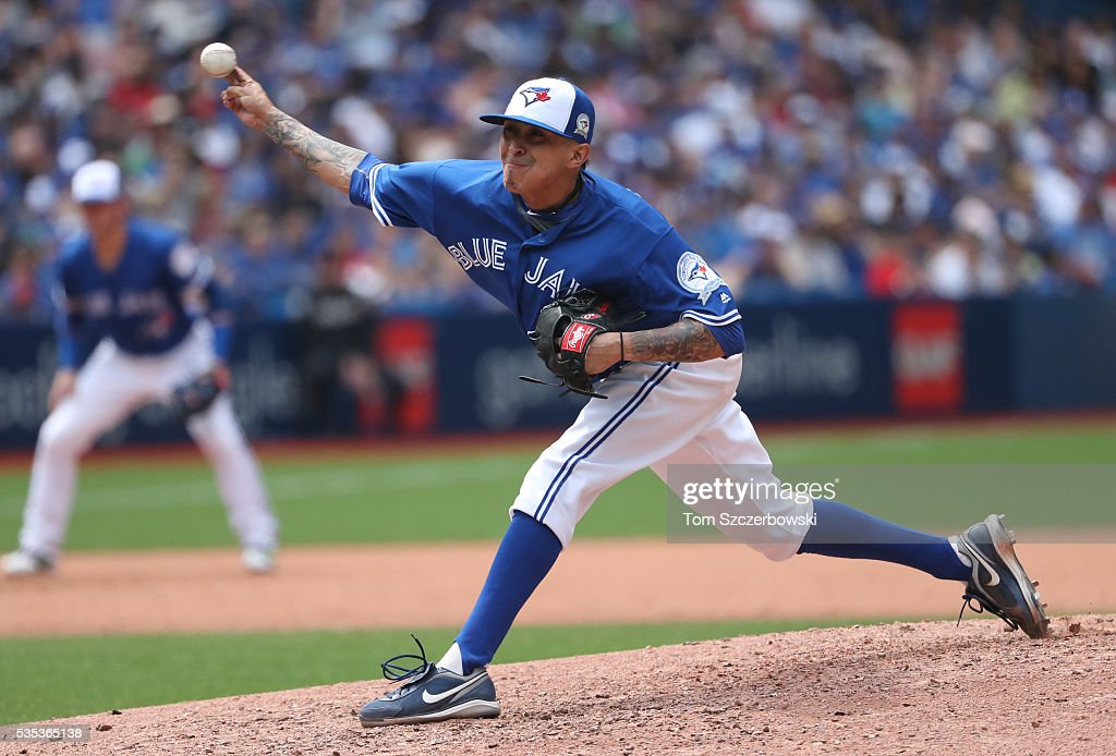 <a gi-track='captionPersonalityLinkClicked' href=/galleries/search?phrase=Jesse+Chavez&family=editorial&specificpeople=4175363 ng-click='$event.stopPropagation()'>Jesse Chavez</a> #30 of the Toronto Blue Jays delivers a pitch in the sixth inning during MLB game action against the Boston Red Sox on May 29, 2016 at Rogers Centre in Toronto, Ontario, Canada.