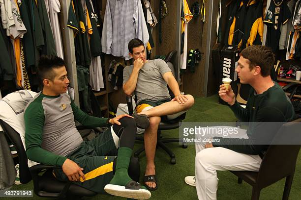 Jesse Chavez Tommy Milone and Scott Kazmir of the Oakland Athletics relax in the clubhouse prior to the game against the Washington Nationals at Oco...