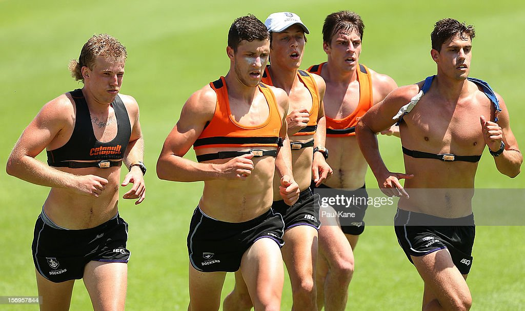 Jesse Crichton, Sam Menegola, Cameron Sutcliffe, Nick Suban and Garrick Ibbotson run during a Fremantle Dockers AFL pre-season training session at Fremantle Oval on November 26, 2012 in Fremantle, Australia.