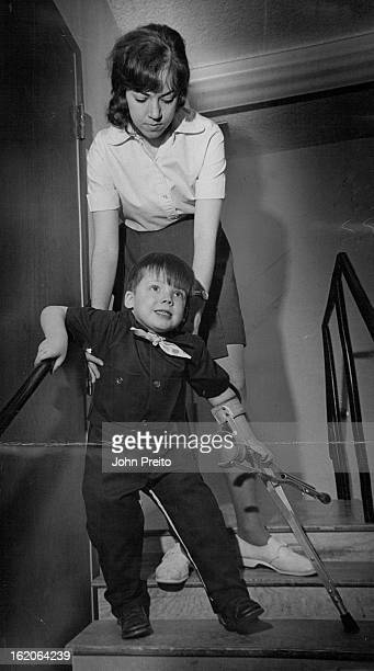 APR 10 1970 APR 15 1970 Jesse Ditson with help of Jennifer Carpenter Jefferson County Easter Seal therapist learns to descend stairs using crutch in...