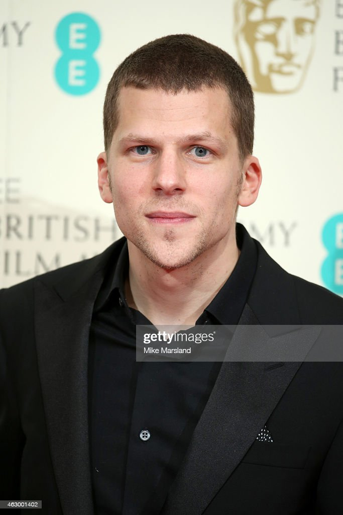 Jesse Eisenberg poses in the winners room at the EE British Academy ...