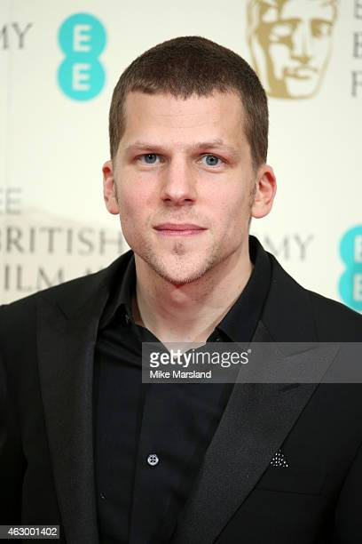 Jesse Eisenberg poses in the winners room at the EE British Academy Film Awards at The Royal Opera House on February 8 2015 in London England
