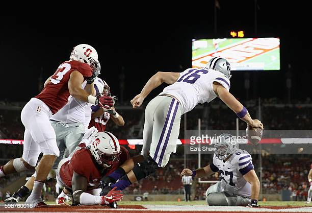 Jesse Ertz of the Kansas State Wildcats is sacked in the endzone by Jordan Watkins of the Stanford Cardinal for a safety at Stanford Stadium on...