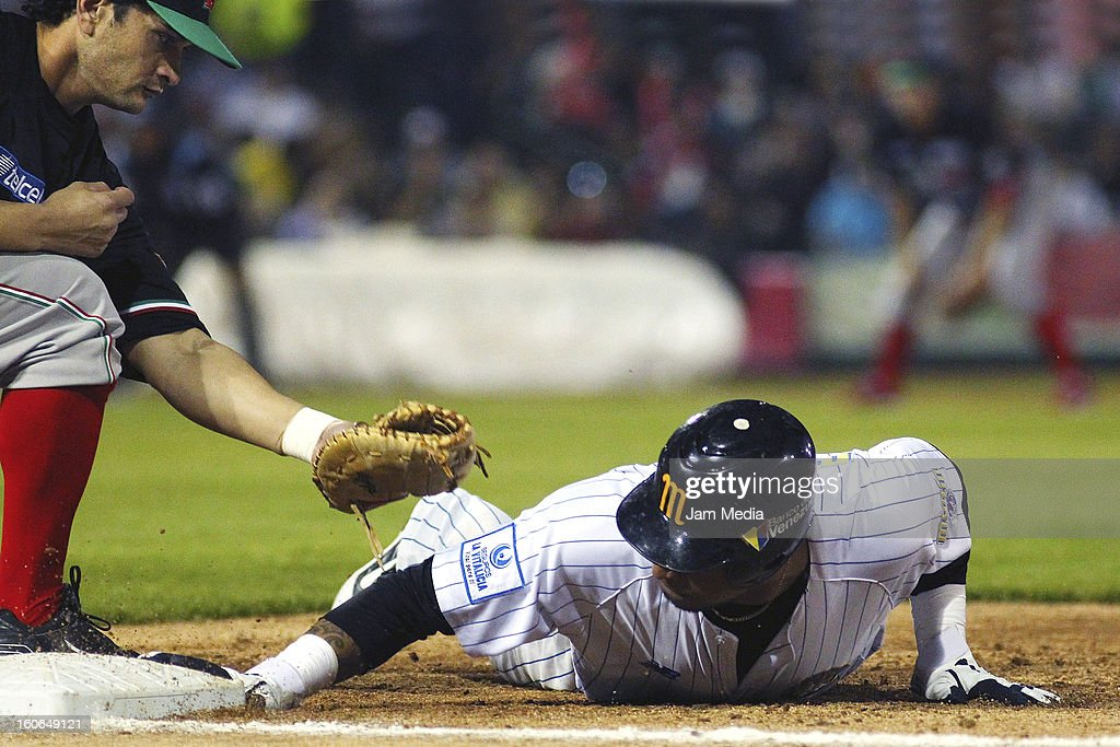 Jesse Gutierrez of Mexico and Jose Castillo of Venezuela in action during the Caribbean Series Baseball 2013 in Sonora Stadium on February 2, 2013 in Hermosillo, Mexico.