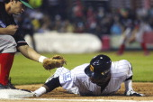 Jesse Gutierrez of Mexico and Jose Castillo of Venezuela in action during the Caribbean Series Baseball 2013 in Sonora Stadium on February 2 2013 in...