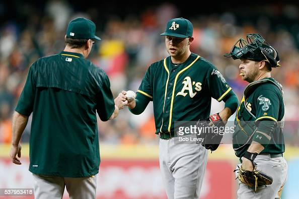 Jesse Hahn of the Oakland Athletics hands the ball to manager Bob Melvin as he leaves the game in the first inning against the Houston Astros at...