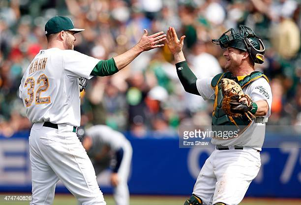Jesse Hahn of the Oakland Athletics is congratulated by catcher Stephen Vogt after he pitched a complete game shutout against the Detroit Tigers at...