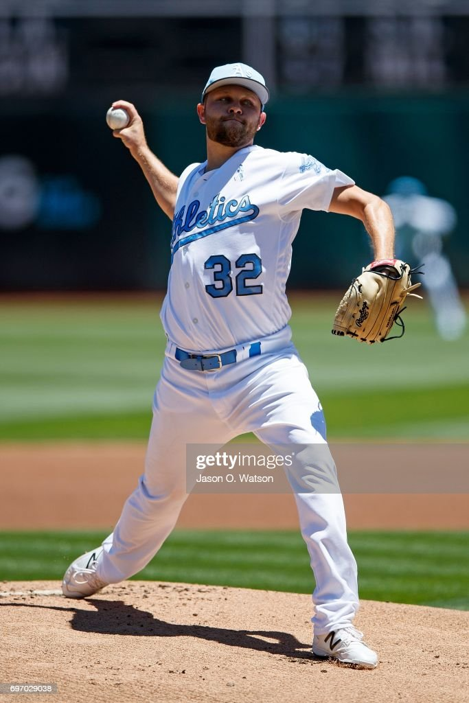 Jesse Hahn #32 of the Oakland Athletics pitches against the New York Yankees during the first inning at the Oakland Coliseum on June 17, 2017 in Oakland, California. Players and umpires are wearing blue to celebrate Father's Day weekend and support prostrate cancer awareness.
