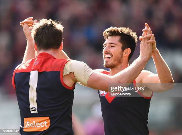 Jesse Hogan and Alex NealBullen of the Demons celebrate a goal during the round 22 AFL match between the Melbourne Demons and the Brisbane Lions at...