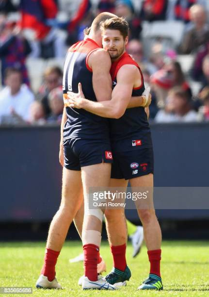 Jesse Hogan and Max Gawn of the Demons celebrate a goal during the round 22 AFL match between the Melbourne Demons and the Brisbane Lions at...