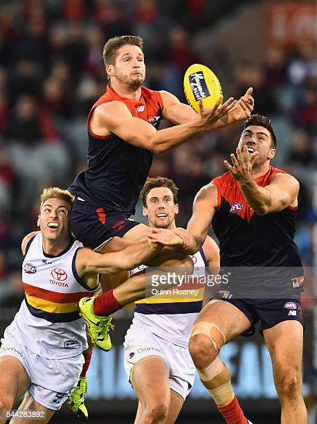 Jesse Hogan of the Demons attempts to mark over the top of Daniel Talia of the Crows during the round 15 AFL match between the Melbourne Demons and...
