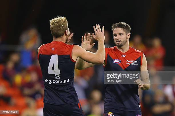 Jesse Hogan of the Demons celebrates a goal during the round seven AFL match between the Gold Coast Suns and the Melbourne Demons at Metricon Stadium...
