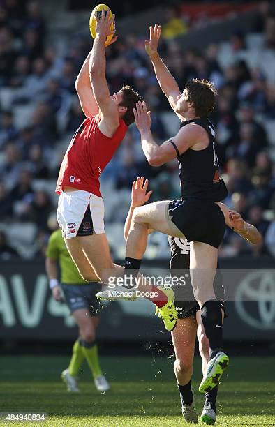 Jesse Hogan of the Demons compete for the ball against Sam Rowe of the Blues during the round 21 AFL match between the Carlton Blues and the...