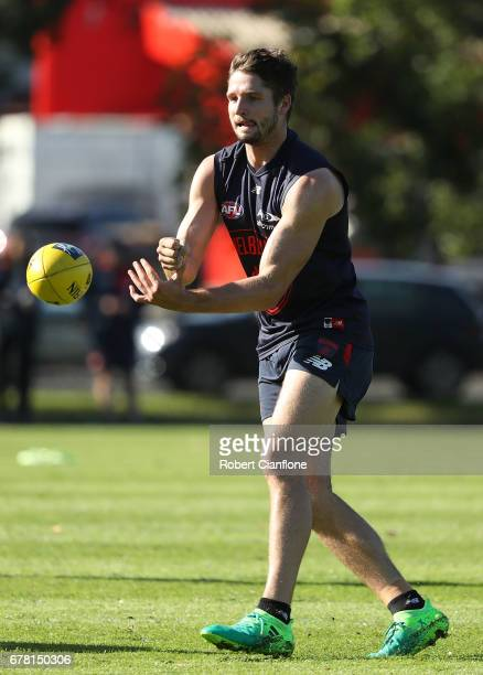 Jesse Hogan of the Demons handballs during a Melbourne Demons AFL training session at Gosch's Paddock on May 4 2017 in Melbourne Australia