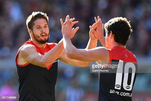 Jesse Hogan of the Demons is congratulated by Angus Brayshaw after kicking a goal during the round four AFL match between the Collingwood Magpies and...
