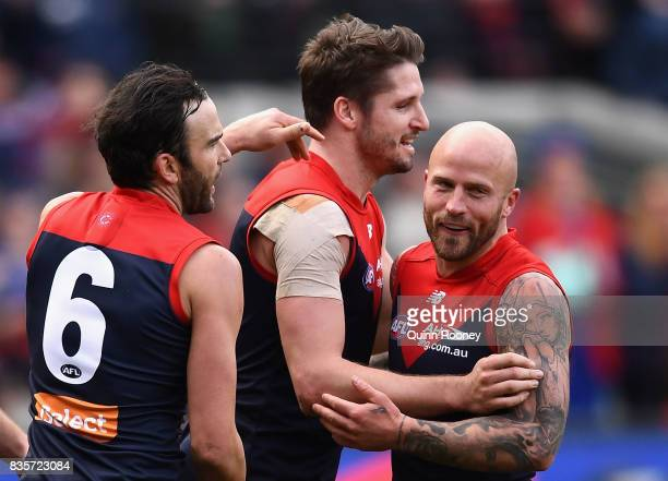 Jesse Hogan of the Demons is congratulated by Jordan Lewis and Nathan Jones after kicking a goal during the round 22 AFL match between the Melbourne...