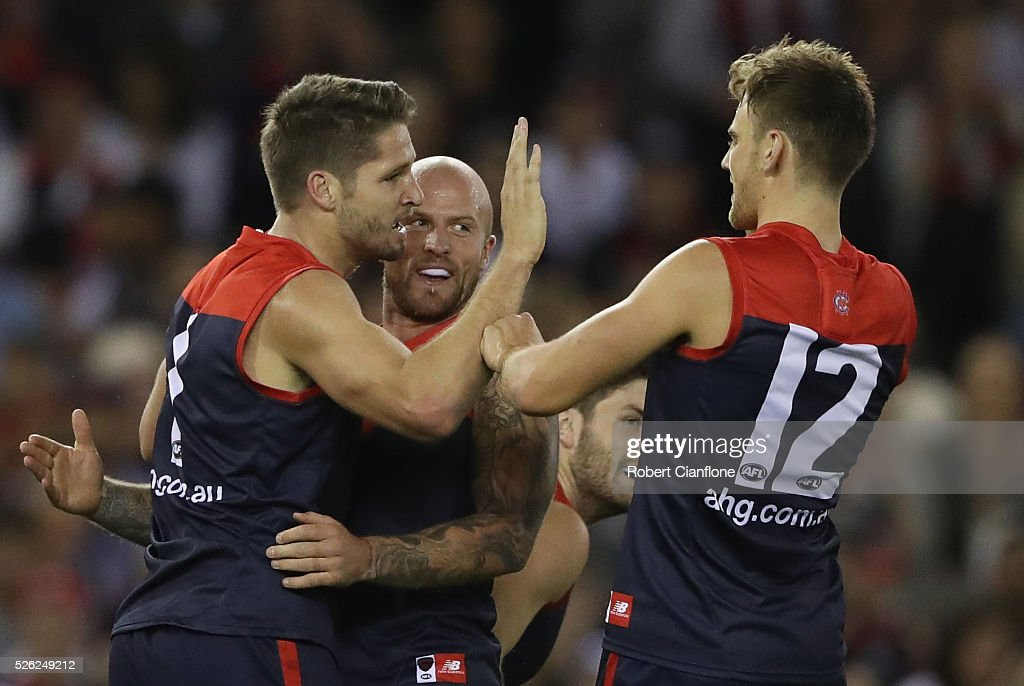 Jesse Hogan of the Demons is congratulated by team mates after kicking a goal during the round six AFL match between the Melbourne Demons and the St Kilda Saints at Etihad Stadium on April 30, 2016 in Melbourne, Australia.