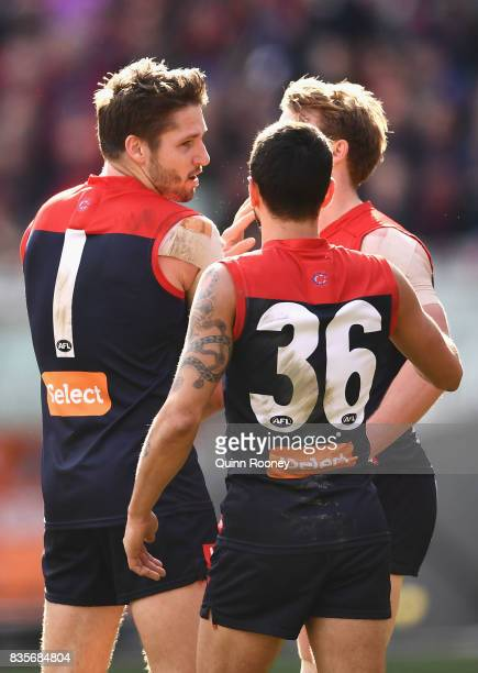 Jesse Hogan of the Demons is congratulated by team mates after kicking a goal during the round 22 AFL match between the Melbourne Demons and the...
