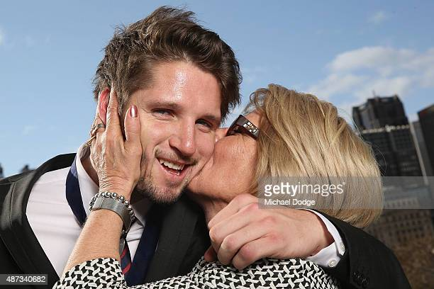 Jesse Hogan of the Demons is kissed by his mum Julie Hogan after winning the 2015 AFL Rising Star at Crown Palladium on September 9 2015 in Melbourne...