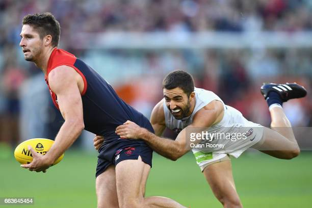 Jesse Hogan of the Demons is tackled by Kade Simpson of the Blues during the round two AFL match between the Melbourne Demons and the Carlton Blues...