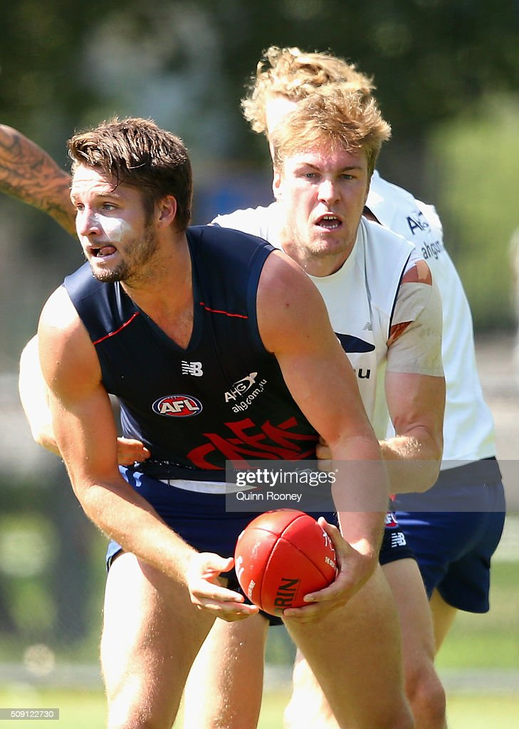 Jesse Hogan of the Demons is tackled by Tom McDonald during a Melbourne Demons AFL pre-season training session at Gosch's Paddock on February 9, 2016 in Melbourne, Australia.